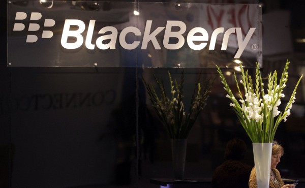 A RIM hostess uses her Blackberry device at the ITU Telecom World in Geneva